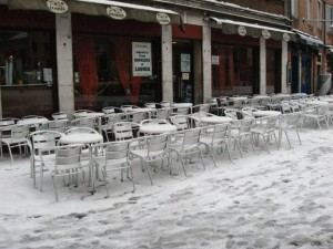 Chairs full of snow in Campo Santa Margherita